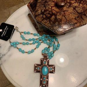 Woman's fancy jewelry imitation turquoise pebbles.